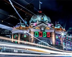 Melbourne CBD car lights at night with Flinders St Station in background