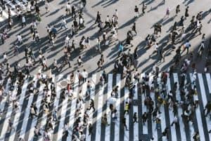 People crossing the road at a busy street intersection
