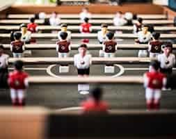 Detail image of foosball table with close up of players on rods